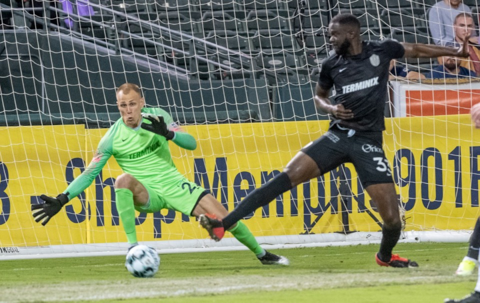 <strong>Memphis goalkeeper Cody Cropper reaches to defend the goal with an asist from Skylar Thomas during an early score by Louisville City FC in Wednesday's match in Memphis.</strong> (Greg Campbell/Special to The Daily Memphian)
