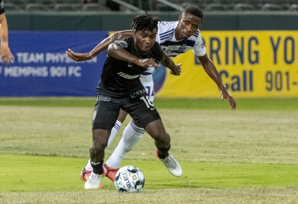 <strong>Memphis 901FC midfielder Dominic Oduro fights for the ball against Louisville City FC midfielder Abdou Thiam.</strong> (Greg Campbell/Special to The Daily Memphian)