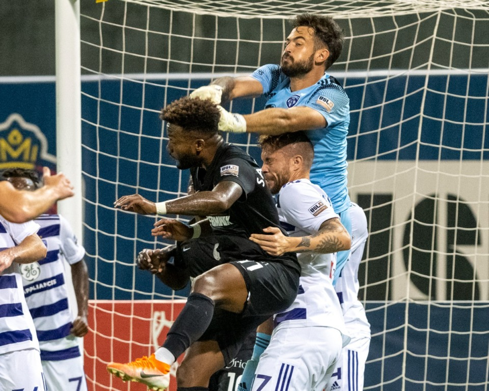 <strong>Memphis 901FC forward Michael Salazar fights Louisville City FC goalkeeper Chris Hubbard and defender Cameron Lancaster for a pass near the goal.</strong>&nbsp;(Greg Campbell/Special to The Daily Memphian)