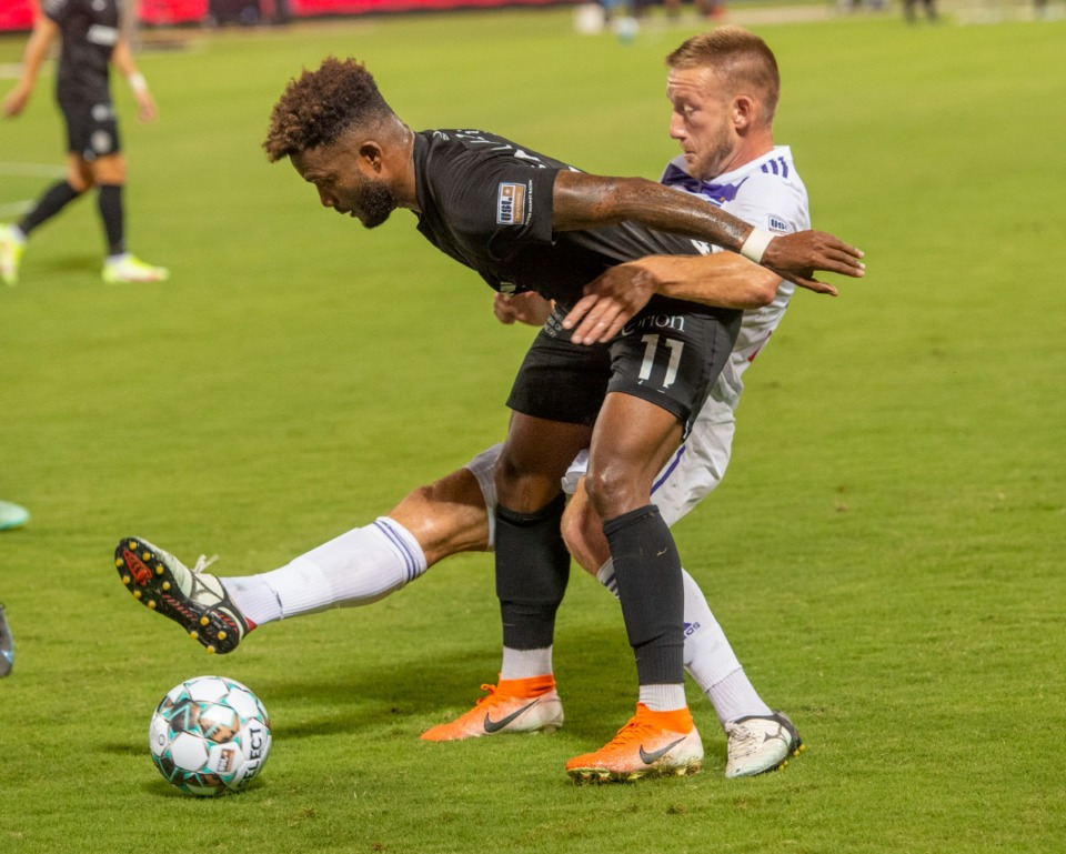 <strong>Memphis forward Michael Salazar hangs onto Lousiville City FC's Sean Totsch in Wednesday's game at AutoZone Park.</strong>&nbsp;(Greg Campbell/Special to The Daily Memphian)