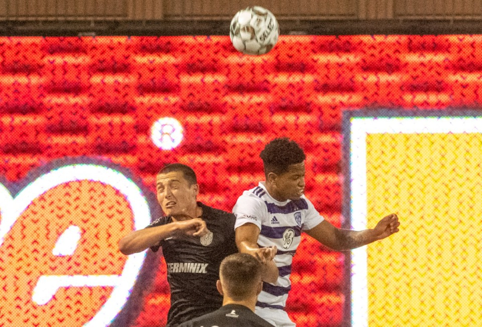 <strong>Memphis 901 FC's Brecc Evans and Louisville City FC's Akil Watts fight for control of the ball in Wednesday's contest in Memphis at AutoZone Park.</strong>&nbsp;(Greg Campbell/Special to The Daily Memphian)