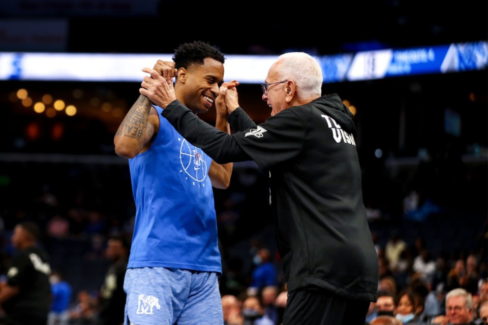 <strong>University of Memphis coach Larry Brown celebrates with Tyler Harris after a huge dunk at Memphis Madness in FedExForum Oct. 13, 2021.</strong> (Patrick Lantrip/Daily Memphian)