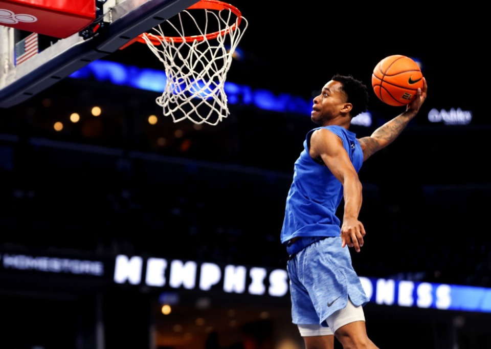 <strong>University of Memphis guard Tyler Harris dunks during a scrimmage at Memphis Madness in FedExForum Oct. 13, 2021.</strong> (Patrick Lantrip/Daily Memphian)