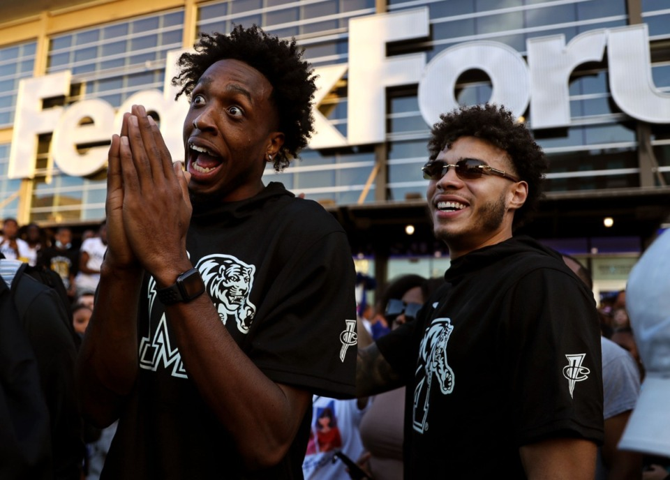 <strong>University of Memphis players DeAndre Williams and Lester Quinones laugh with fans outside of FedExForum before Memphis Madness Oct. 13, 2021.</strong> (Patrick Lantrip/Daily Memphian)