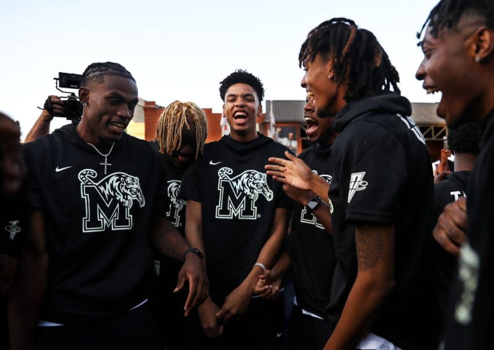 <strong>University of Memphis players dance on the blue carpet outside of FedExForum before Memphis Madness Oct. 13, 2021.</strong> (Patrick Lantrip/Daily Memphian)