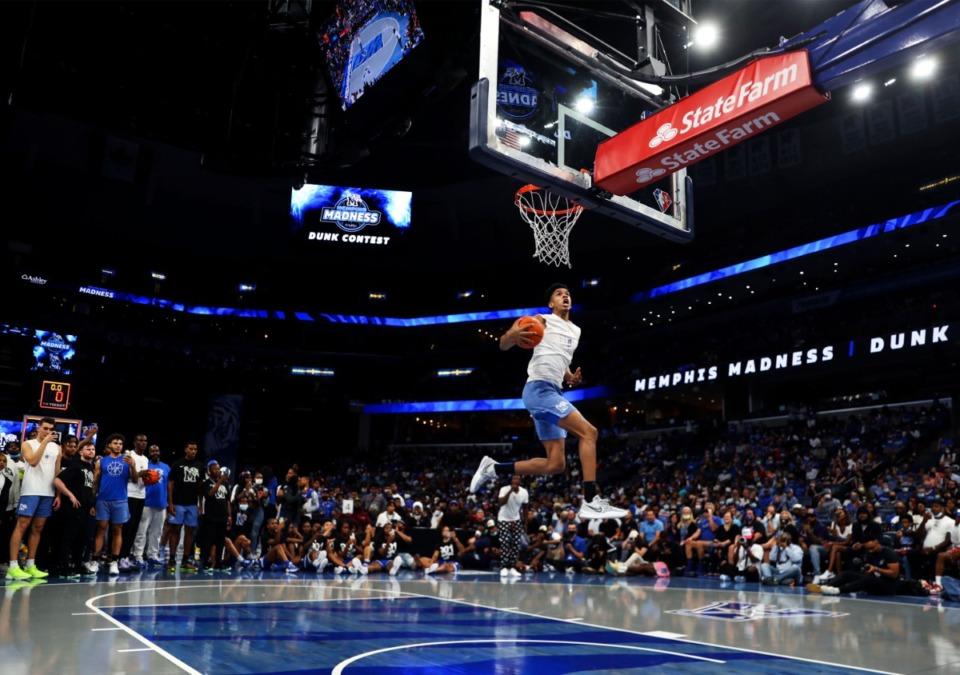 <strong>University of Memphis guard Josh Minott hammers home the winning dunk as the crowd roars at Memphis Madness in FedExForum on Oct. 13, 2021.</strong> (Patrick Lantrip/Daily Memphian)