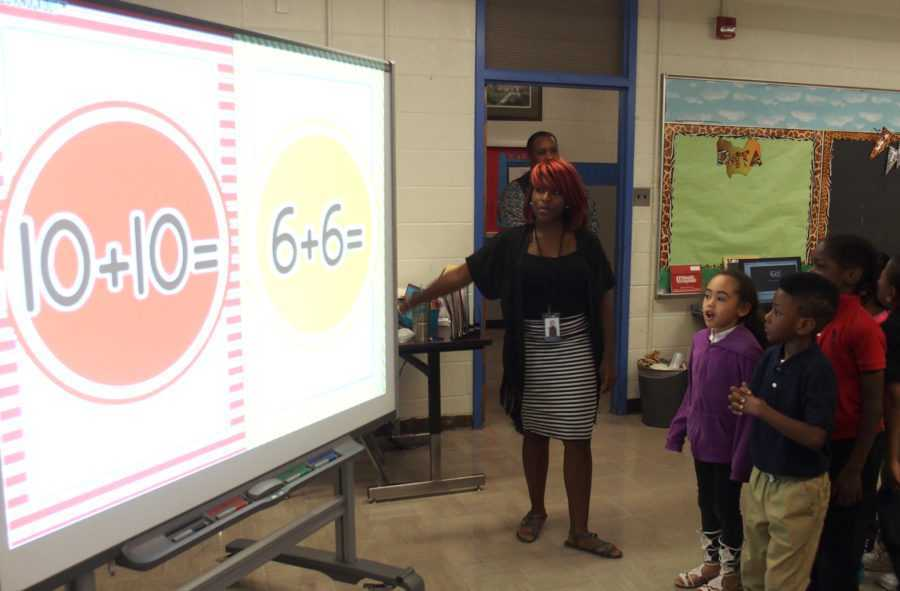 "<p class=""p1""><strong><span class=""s1"">Students at Hawkins Mill Elementary play a math game during class.</span></strong><span class=""s1""> </span><span class=""s2"">(Laura Faith Kebede/Chalkbeat)</span>"