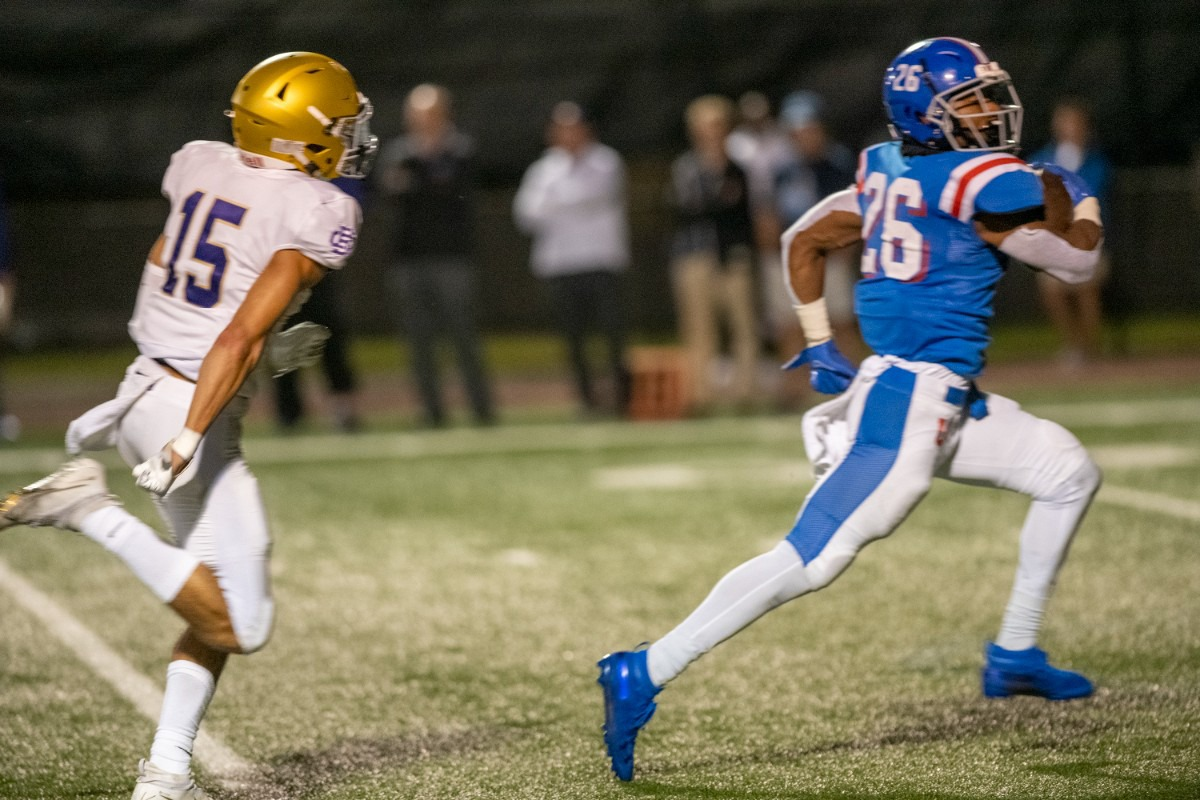 <strong>MUS running back Hunter Barnes scores in the opening drive of the rain-delayed game against CBHS at MUS on Friday, Oct. 15. Chasing after Barnes is CBHS defensive back Patrick Curlee.</strong> (Greg Campbell/Special to The Daily Memphian)