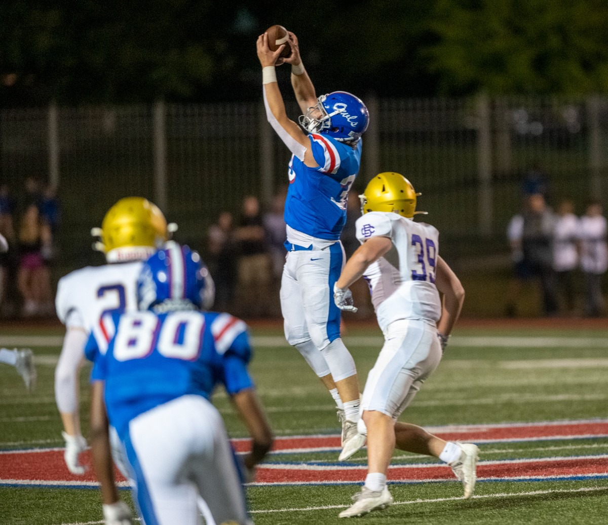 <strong>MUS linebacker Stryker Aitken pulls down an interception intended for CBHS wide receiver Cole Hungate on Oct. 15. The game was delayed for an hour and 15 minutes until a fast-moving storm passed the area.</strong> (Greg Campbell/Special to The Daily Memphian)