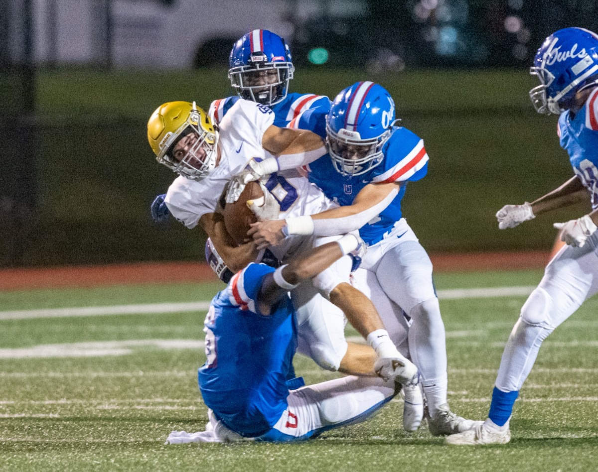 <strong>CBHS wide receiver Whit Collard is smothered by a host of MUS defensive players in one of CBHS's longest runs of the first half.</strong> (Greg Campbell/Special to The Daily Memphian)