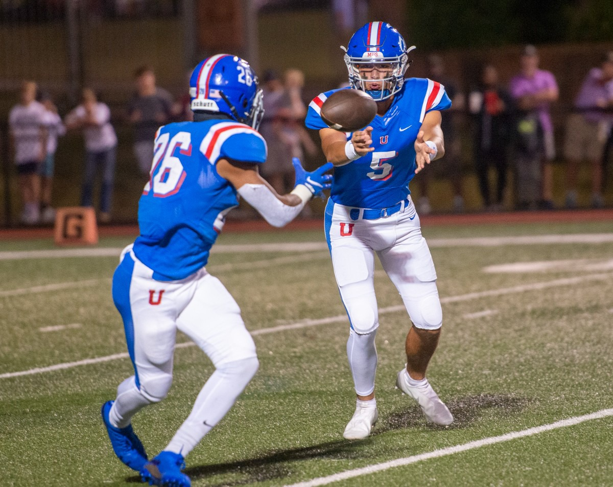<strong>MUS quarterback George Hamsley (5) pitches out to running back Hunter Barnes (26) on Friday, Oct. 15, 2021.</strong> (Greg Campbell/Special to The Daily Memphian)