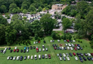 <strong>Overflow parking for the Memphis Zoo spilled onto Overton Park&rsquo;s greensward during July 2019.</strong> (Jim Weber/Daily Memphian file)