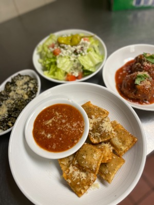 <strong>Some of the items that will be available for takeout at GoGrisanti include Italian spinach (clockwise from left), Miss Mary&rsquo;s salad, meatballs and toasted ravioli.</strong> (Photo courtesy Larkin Grisanti)