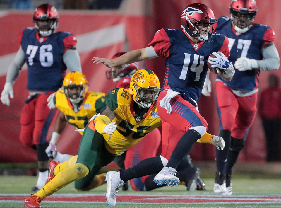 <strong>Memphis Express quarterback Christian Hackenberg looks for an open lane past the Arizona Hotshots' Da'Sean Downey during the home opener of Memphis' new Alliance American Football league team at the Liberty Bowl on Feb. 16, 2019. The Express travel to Orlando to play the Apollos (2-0) Saturday.</strong>&nbsp;(Jim Weber/Daily Memphian)