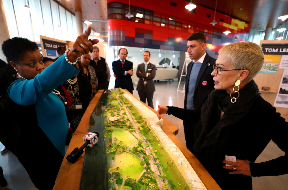 <strong>Memphis City Council member Jamita Swearengen (left) asks Memphis River Parks Partnership president Carol Coletta about redevelopment plans at Tom Lee Park. Council members met with Coletta at Beale Street Landing on Tuesday, Feb. 19, to get a look at the scale model of the plan for redeveloping Tom Lee Park.&nbsp;</strong>(Houston Cofield/Daily Memphian)