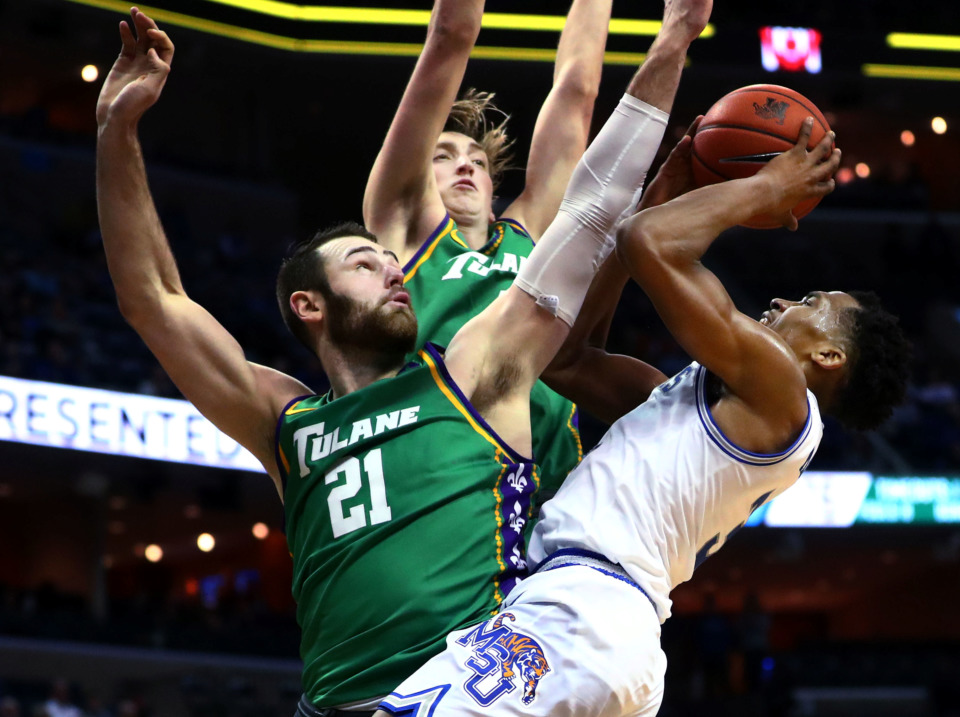 <strong>Memphis Tigers guard Jeremiah Martin (3) pulls back for a shot against Tulane&nbsp; forward Samir Sehic (21) and guard/forward Moses Wood (4) during a game Wednesday, Feb. 20, 2019, in Memphis. Martin scored 43 points, breaking his career record and helping to defeat the Green Wave, 102-76.</strong> (Houston Cofield/Daily Memphian)