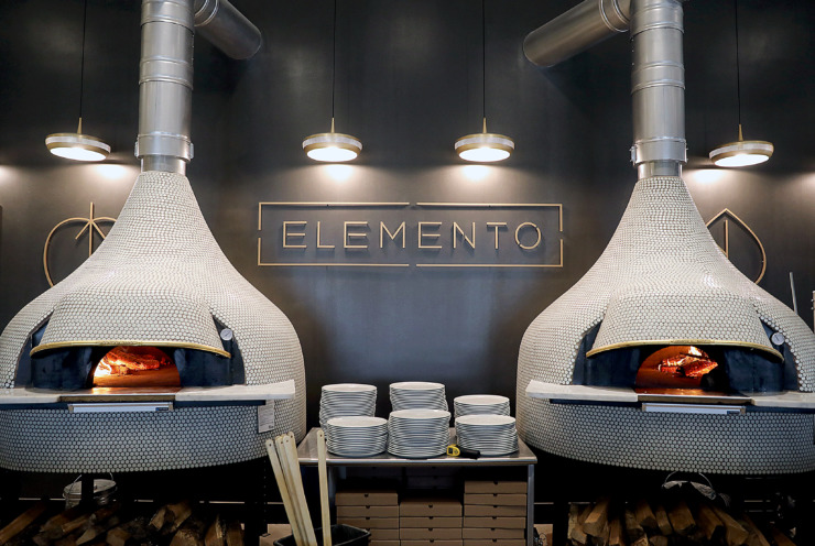 <strong>Elemento's traditional wood-burning ovens are the heart and soul of the restaurant and give the Neapolitan pizzas many of their signature flavor profiles.</strong> (Patrick Lantrip/Daily Memphian)