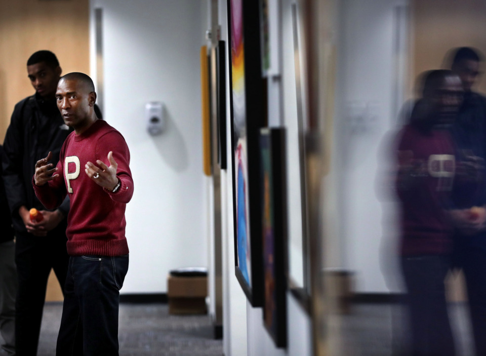 "<p class=""p1""><strong>Elliot Perry discusses where his love for collecting contemporary art originated, and what kinds of artists he's drawn to. Perry recently installed an exhibition of selected pieces from his collection in one of the Memphis Grizzlies' locker rooms.</strong> (Houston Cofield/Daily Memphian)"