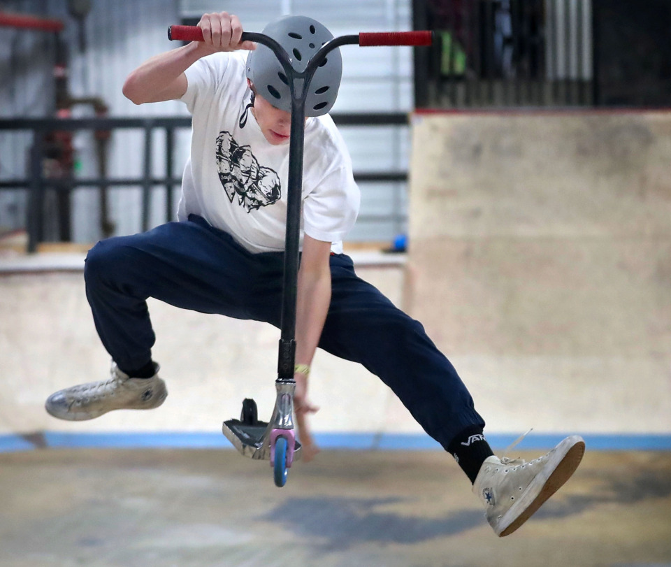 <strong>Sawyer House, 15, performs one of his favorite tricks, a finger whip, while practicing technique at the new Society Skatepark &amp; Coffee, an industrial warehouse in Binghampton that was transformed by local skate enthusiasts Mark Horrocks, Matthew Wrage and Zac Roberts.</strong> (Jim Weber/Daily Memphian)