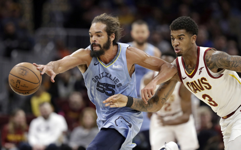 <strong>Memphis Grizzlies' Joakim Noah (55) and Cleveland Cavaliers' Marquese Chriss (3) battle for a loose ball in the first half of an NBA game, Saturday, Feb. 23, 2019, in Cleveland.</strong> (AP Photo/Tony Dejak)