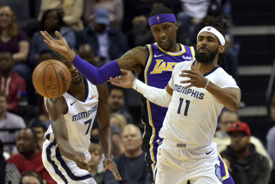 <span><strong>Memphis Grizzlies guard Mike Conley (11), Los Angeles Lakers guard Kentavious Caldwell-Pope, center, and Grizzlies forward Justin Holiday (7) struggle for control of the ball in the first half of an NBA basketball game Monday, Feb. 25, 2019, in Memphis, Tenn.</strong> (AP Photo/Brandon Dill)</span>