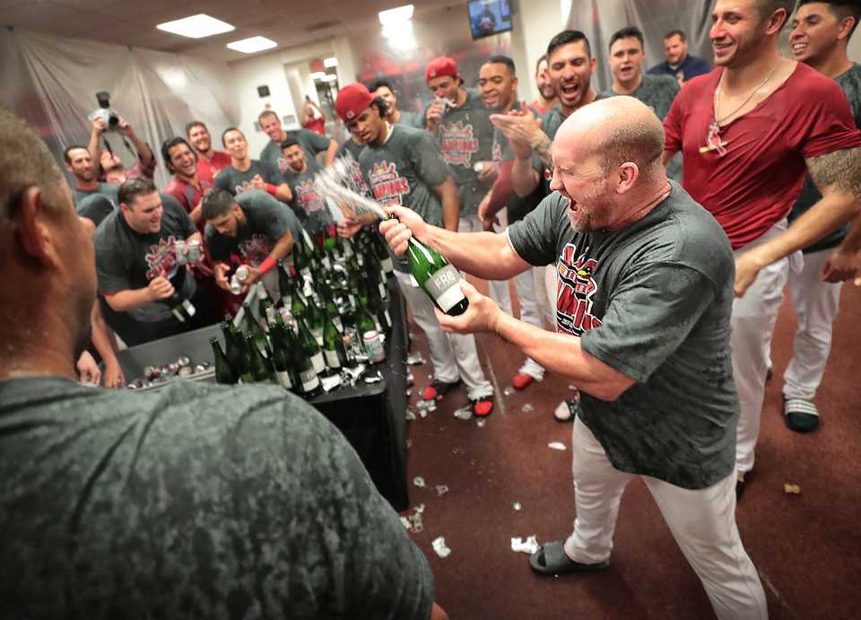 <strong>Redbirds Manager Stubby Clapp (right) celebrates with the team after winning game four of the Redbird's Pacific Coast League series against Fresno at Autozone Park on September 15, 2018. Memphis beat the Grizzlies 5-0 to win their second straight PCL title.</strong> (Jim Weber/The Daily Memphian)