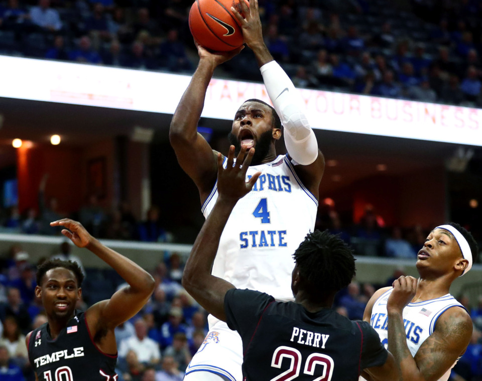 <strong>Memphis Tigers forward Raynere Thornton (4) pulls up for shot during a game against the Temple Owls on Tuesday, Feb. 26, 2019.</strong> (Houston Cofield/Daily Memphian)