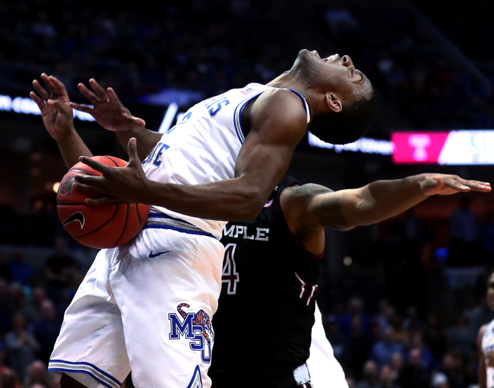 <strong>Memphis Tigers guard Alex Lomax (2) is fouled by defenders during a game against the Temple Owls on Tuesday, Feb. 26, 2019. The Tigers defeated the Owls 81-73.</strong> (Houston Cofield/Daily Memphian)