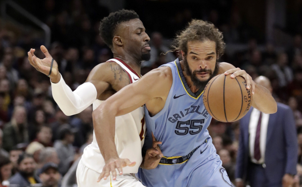<span><strong>Memphis Grizzlies' Joakim Noah (55) drives past Cleveland Cavaliers' David Nwaba (12) in the second half of an NBA basketball game, Saturday, Feb. 23, 2019, in Cleveland. The Cavaliers won 112-107.</strong> (AP Photo/Tony Dejak)</span>