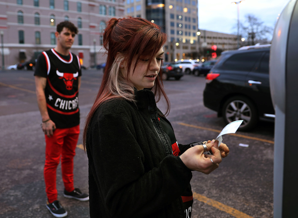 <strong>Danica Cissell and Justin Vogel pay for parking in Downtown Memphis Wednesday, Feb. 27, 2019, after driving in from Dresden, Tennessee, to see their Chicago Bulls take on the Memphis Grizzlies. While Memphians have expressed the desire for more Downtown parking, the city is working toward a culture shift of getting drivers to pay higher rates and walk farther to park.</strong>&nbsp;(Patrick Lantrip/Daily Memphian)