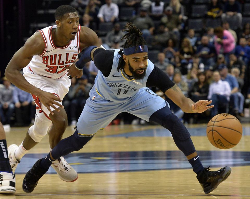 <span><strong>Memphis Grizzlies guard Mike Conley (11) controls the ball ahead of Chicago Bulls guard Kris Dunn (32) in the first half of an NBA basketball game Wednesday, Feb. 27, 2019, in Memphis, Tenn.</strong> (AP Photo/Brandon Dill)</span>