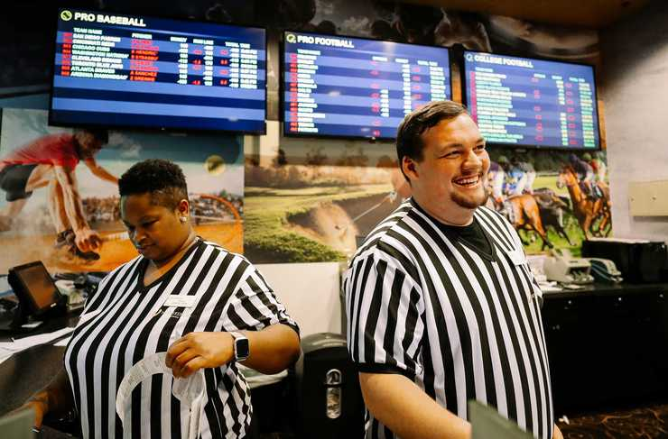 <strong>Erica Shirley (left) and Graham Lowing  became employees at Horseshoe Casino to work in its new sports betting lounge. Mississippi joins Nevada, Delaware, New Jersey and West Virginia in making sports betting legal in the state.</strong> (Houston Cofield/Daily Memphian)
