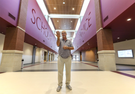 <strong>Collierville Schools superintendant John Aitken leads a tour of Collierville High Aug. 7, 2018, a week before the $90 million new school welcomes its first students. Aitken announced Thursday he is retiring as superintendent at the end of June.</strong> (Houston Cofield/Daily Memphian file)