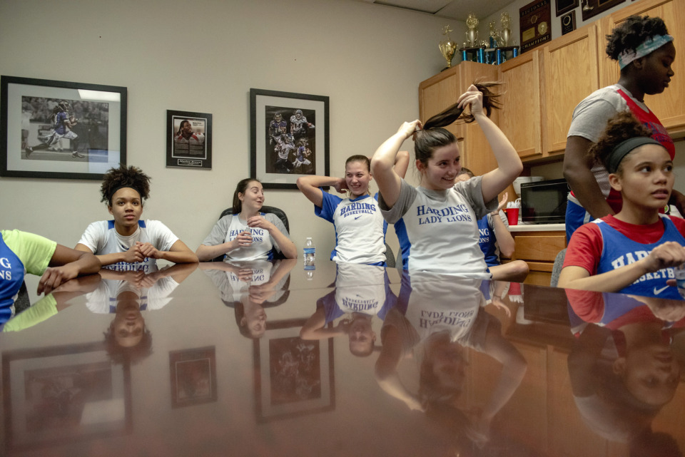 <strong>The Harding Academy girls basketball team watches footage during practice at the school on Feb. 25, 2019 in Memphis, Tenn.</strong> (Brandon Dill/Special To The Daily Memphian)