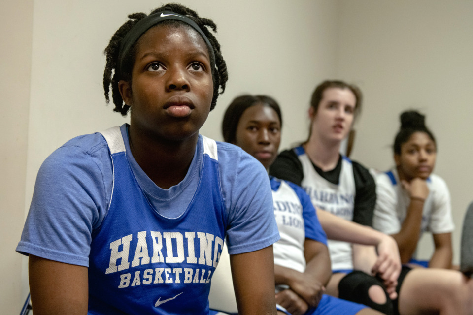 <strong>Makyah Thomas, left, watches footage with teammates during Harding Academy girls basketball practice at the school on Feb. 25, 2019 in Memphis, Tenn.</strong> (Brandon Dill/Special To The Daily Memphian)