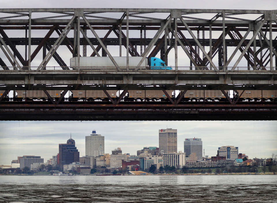 <strong>Truck and train traffic pass over the Mississippi River at the Highway 55 bridge on Feb. 27, 2019. The river was expected to crest the week of March 3 at 41 feet, the fourth-highest level on record for the Memphis area.</strong> (Jim Weber/Daily Memphian)