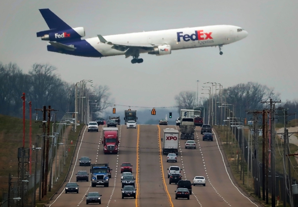 <strong>A FedEx plane passes low over Shelby Drive as it lands at Memphis International Airport. Mainly due to the presence of the FedEx hub, Memphis International is the world's second-largest cargo airport.</strong> (Jim Weber/Daily Memphian)