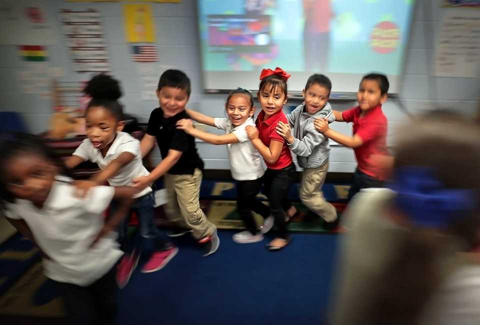 <strong>Yvonne Thomas' kindergarteners dance to a song about fruit in one of Treadwell Elementary School's dual language classes on September 21, 2018. Treadwell's dual language program immerses kids in both Spanish and English for full fluency by fifth grade. It's the only program of its kind in Tennessee.</strong> (Jim Weber/Daily Memphian)
