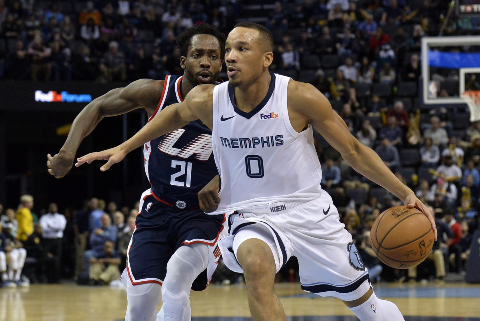 <strong>Memphis Grizzlies guard Avery Bradley (0) drives against Los Angeles Clippers guard Patrick Beverley (21) Friday, Feb. 22, 2019, in Memphis.</strong> (AP Photo/Brandon Dill)