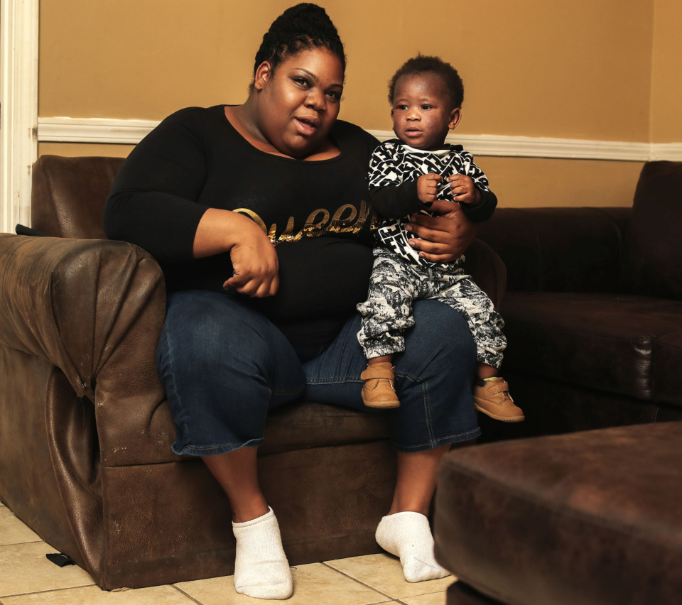 <strong>Cincelia Evans, a tax professional, sits with her 1-year-old son in their Orange Mound home. Evans and her family are participating in Le Bonhuer's Family Resilience Initiative, which assists children living in poverty.</strong> (Houston Cofield/Daily Memphian)