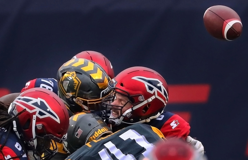 <strong>Myles Nash (91) of the San Diego knocks away a pass attempt by Memphis Express quaterback Zach Mettenberger (8) during their AAF league game at the Liberty Bowl on March 2, 2019.</strong> (Jim Weber/Daily Memphian)