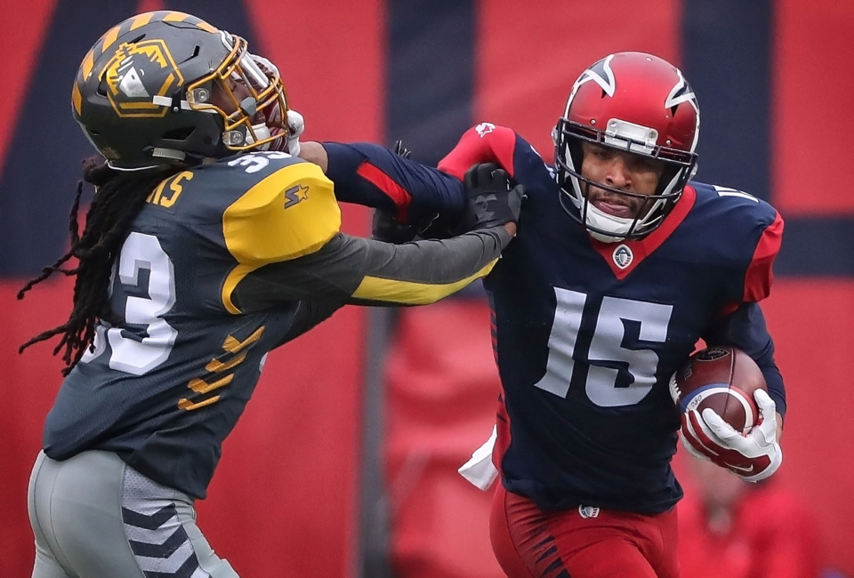 <strong>Memphis Express Devin Lucien (15) straight arms a San Diego Fleet defender on a run during their AAF league game at the Liberty Bowl on March 2, 2019.</strong> (Jim Weber/Daily Memphian)