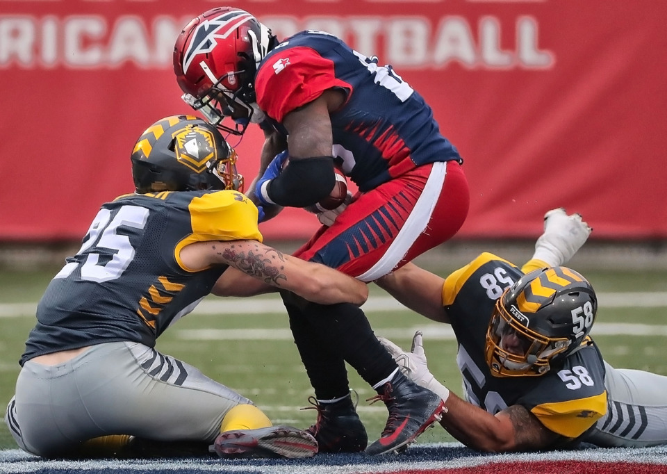 <strong>Memphis Express running back Zac Stacy (center) is taken down for a short gain against the San Diego Fleet during their AAF league game at the Liberty Bowl on March 2, 2019.</strong> (Jim Weber/Daily Memphian)