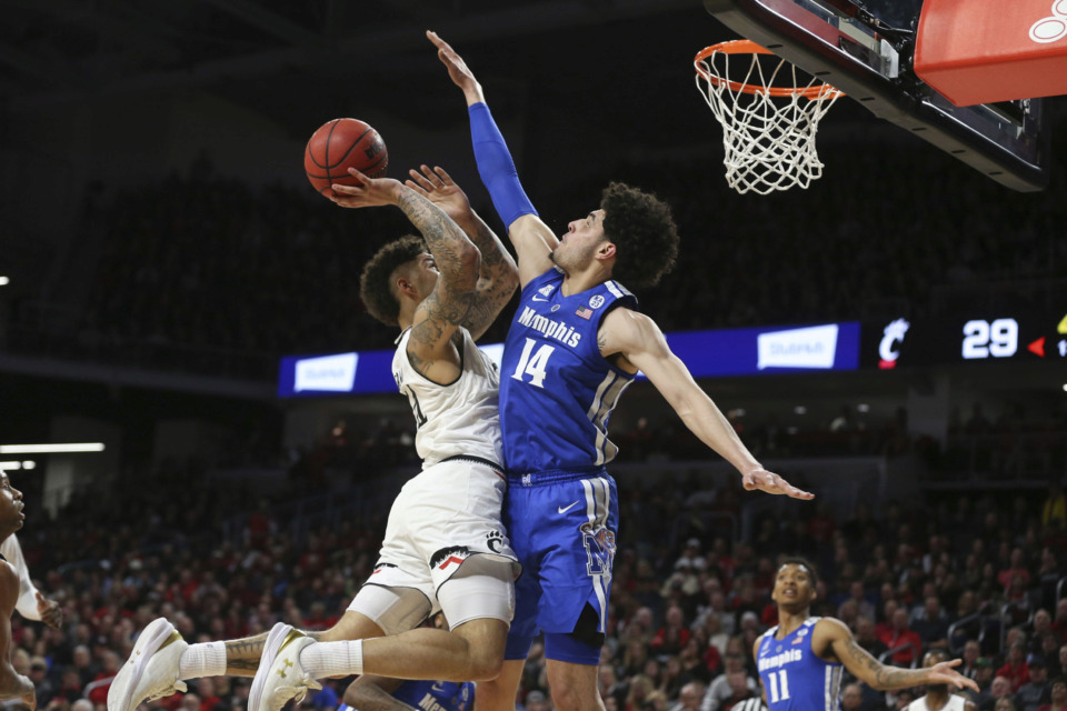 <strong>Cincinnati Bearcats guard Jarron Cumberland (34) gets fouled by Tigers forward&nbsp;Isaiah Maurice&nbsp;while driving to the basket during the University of Memphis game against the Cincinnati Bearcats on March 2nd 2019, at Fifth Third Arena in Cincinnati.</strong> (Icon Sportswire via AP Images)