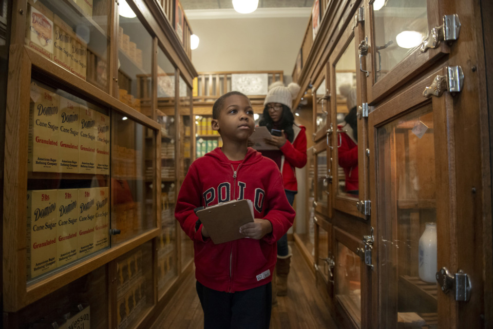 <strong>Keirian White, 6, and his mother, Lakeria White, search for a list of groceries in a model Piggly Wiggly store during community opening day at the Memphis Pink Palace Museum on March 3, 2019. The free event celebrated the opening of &ldquo;Making Memphis: 200 Years of Community&rdquo; and gave visitors a chance to tour the newly renovated Pink Palace mansion.</strong> (Brandon Dill/Special to The Daily Memphian)