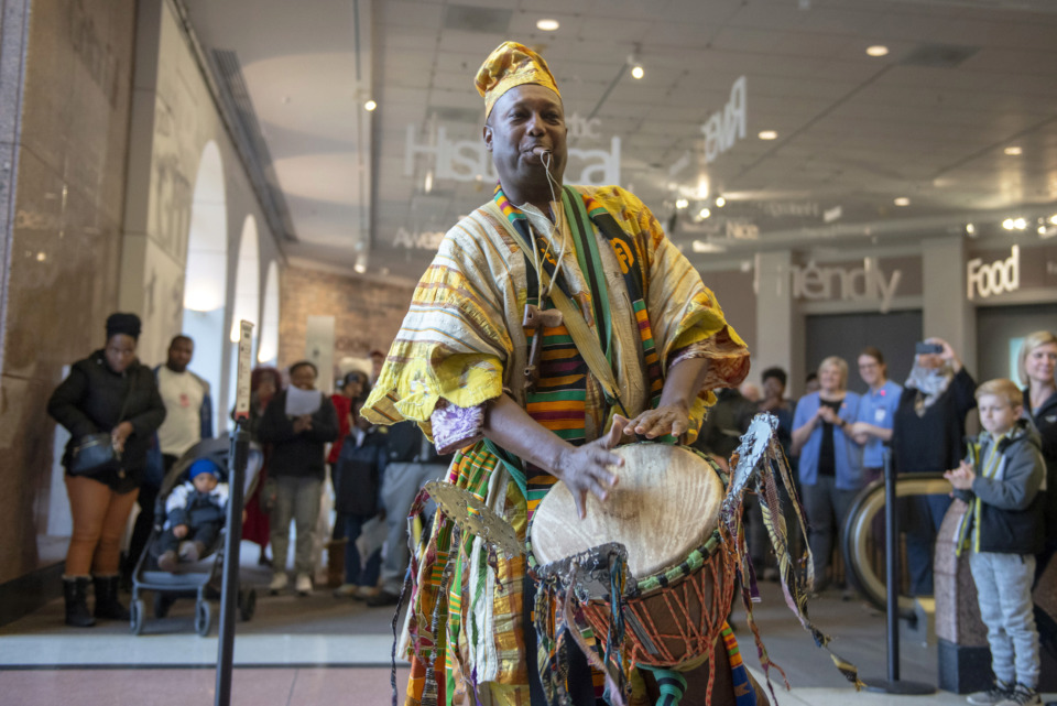 <strong>Ekpe Abioto performs for a crowd of visitors during community opening day at the Memphis Pink Palace Museum on March 3, 2019. The free event drew a large crowd, with performances by a variety of musicians and traditional dance groups.</strong> (Brandon Dill/Special to The Daily Memphian)