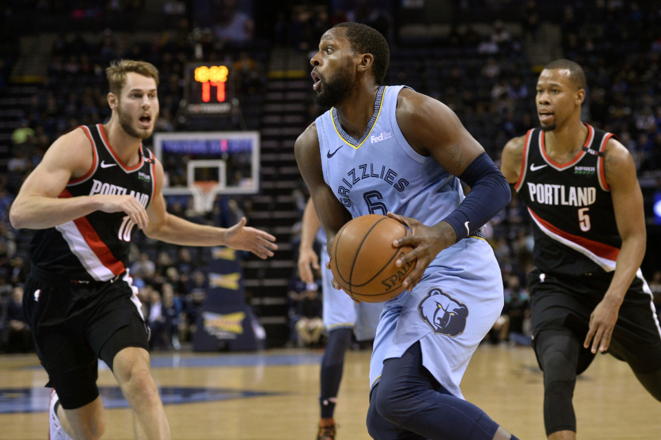 <span><strong>Memphis Grizzlies forward C.J. Miles (6) drives to the basket between Portland Trail Blazers forward Jake Layman (10) and Blazers guard Rodney Hood (5) on Tuesday, March 5, 2019, in Memphis, Tenn.</strong> (AP Photo/Brandon Dill)</span>