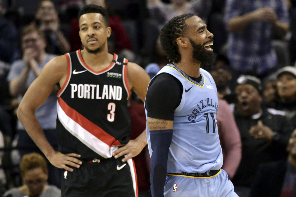 <span><strong>Memphis Grizzlies guard Mike Conley (11) and Portland Trail Blazers guard CJ McCollum (3) react after Conley scored during the second half of an NBA basketball game Tuesday, March 5, 2019, in Memphis, Tenn.</strong> (AP Photo/Brandon Dill)</span>