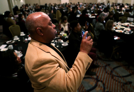<strong>Daryl Moore, father of Chloe Moore, records his daughter speaking on a panel of women leaders during New Memphis' Celebrate What's Right luncheon </strong><strong>Tuesday, March 6, 2019, at the Holiday Inn University of Memphis.</strong> (Houston Cofield/Daily Memphian)