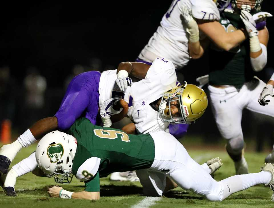 <strong>Christian Brothers High School running back Will Ruth is tackled by a Briarcrest linebacker. Briarcrest and CBHS played at Briarcrest on Friday, Sept. 28.</strong> (Houston Cofield/Daily Memphian)